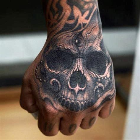 third eye tattoo on finger 20 skull hands tattoos for men