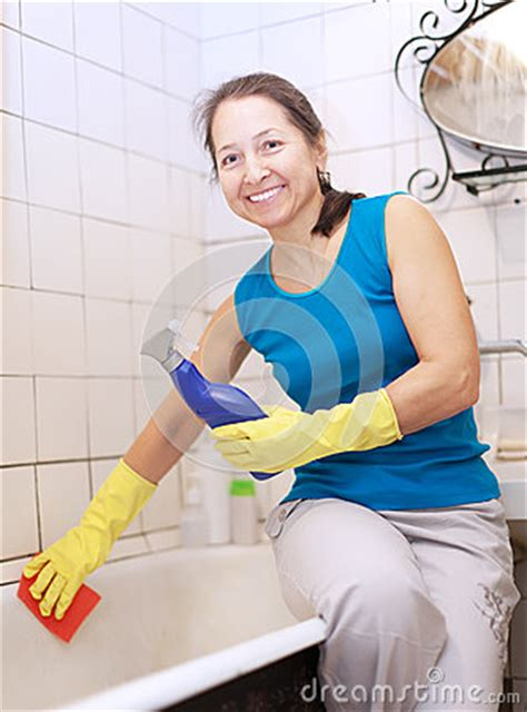 mature bathtub mature woman cleans bathtub royalty free stock photo image 28687485