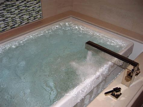 infinity bathtub kohler infinity edge tub filling the bath tub but