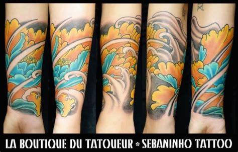 arm blumen japanische wellen tattoo von sebaninho tattoo