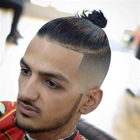 to short top knot men 25 man bun hairstyles which will turn a lot of heads