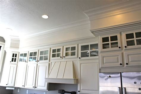 space between kitchen cabinets and ceiling soffit with trim get rid of that awkward space between