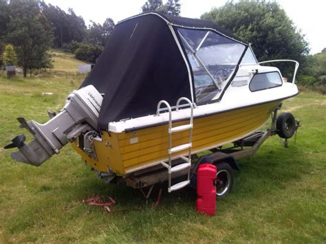 nautiglass cuddy cabin with 50 hp johnson outboard and