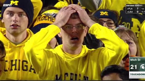 michigan wolverines fan stunned michigan fan chris baldwin can t get away from his