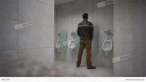 man bathroom public bathroom man uses urinal stock video footage 8953709