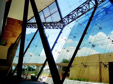 slanted curtain wall angled curtain wall point supported spider system with