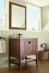Soft fresh from nature hues mix with warm woods in a bath whose style