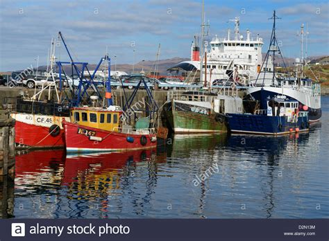 boat transport scotland fishing boats and car ferry in the harbour mallaig