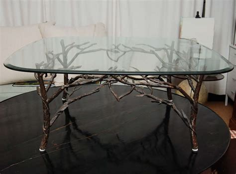 glass top coffee table with tree leg base at 1stdibs