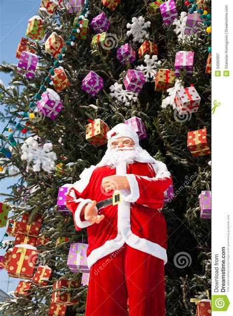 img of santa claus and x mas tree doll santa claus and tree after snowfall stock image image 34592007
