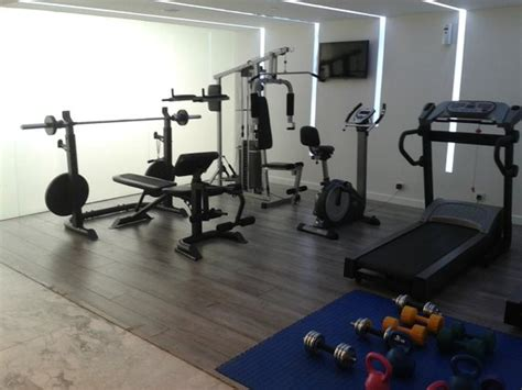 universal bench press gym with bench press universal machine bicycle treadmills and kettlebells picture