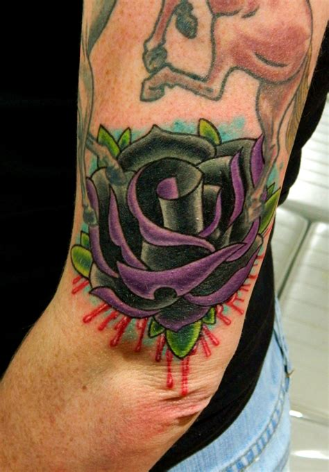 black and purple rose tattoo black and purple traditional by sirius on