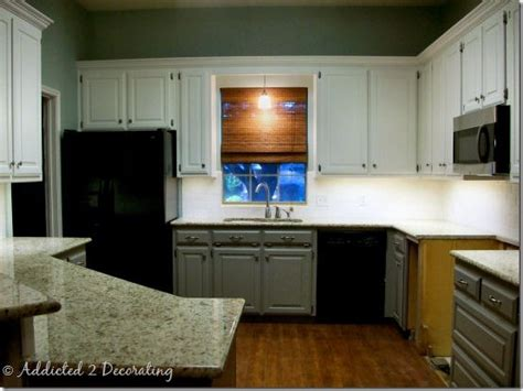 top cabinets alabaster by sherwin williams bottom cabinets elephant skin by behr color