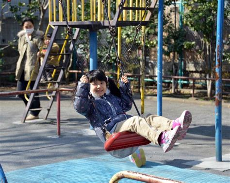 ta swing can t a kid have fun anymore a girl plays on a swing at