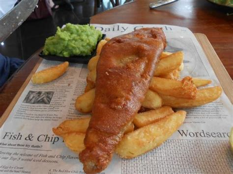 boat house quorn fish and chips served on paper picture of pillings boat