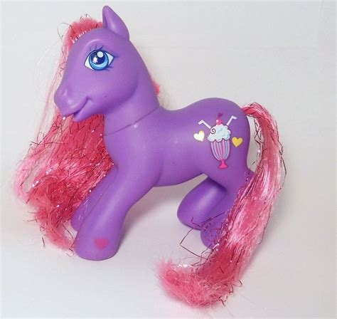 Mainan My Pony Light Up Yellow mlp fizzy pop is a purple pony with pink tinsel hair