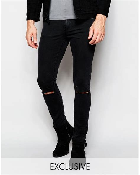 Cheap Monday Black Rips Knee Only cheap monday tight fit black ripped knee