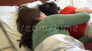 single mother and son sleeping together stock footage video