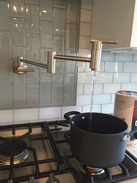 Pot Filler Kitchen Faucet adorable pot filler faucet with black pan and cooktop also