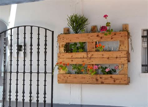 17 helpful tips before painting wooden pallets pallet ideas 1001 pallets need to and pallets recycle wood pallets in the flower garden
