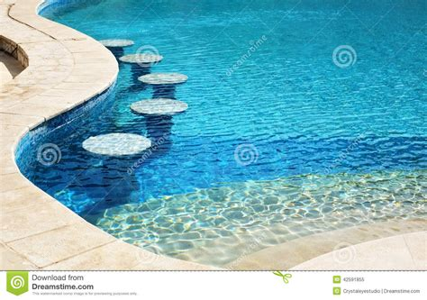 swimming pool bar area with seats underwater stock photo