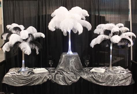 black feather centerpieces feather centerpiece rentals continental feathers