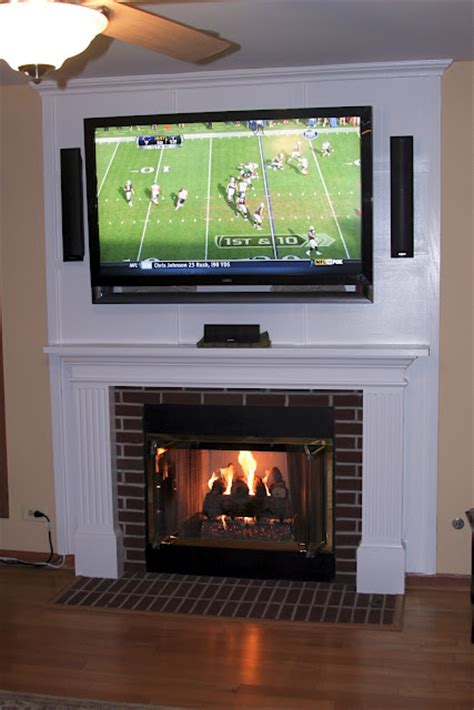 mounting a tv above a fireplace and hiding the cords