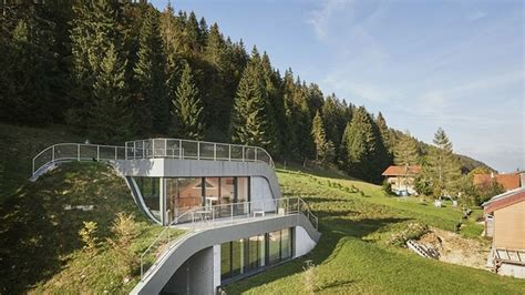 homes built into hillside swooping french home is partially built into a hillside