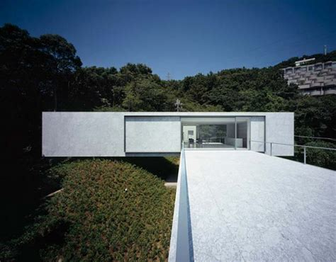 white concrete house construction with open plan interior