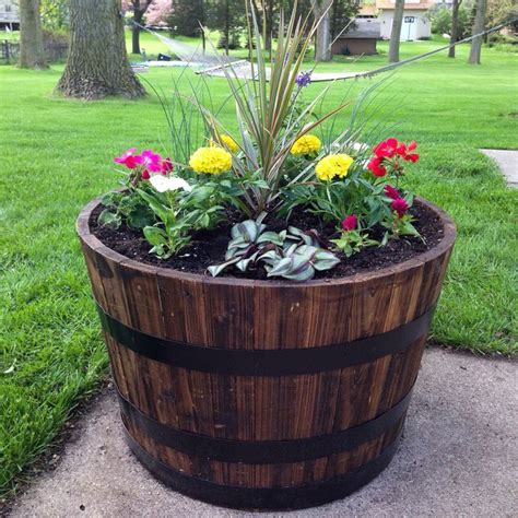 Wooden Barrel Planters At Lowes by 25 Best Ideas About Whiskey Barrel Planter On