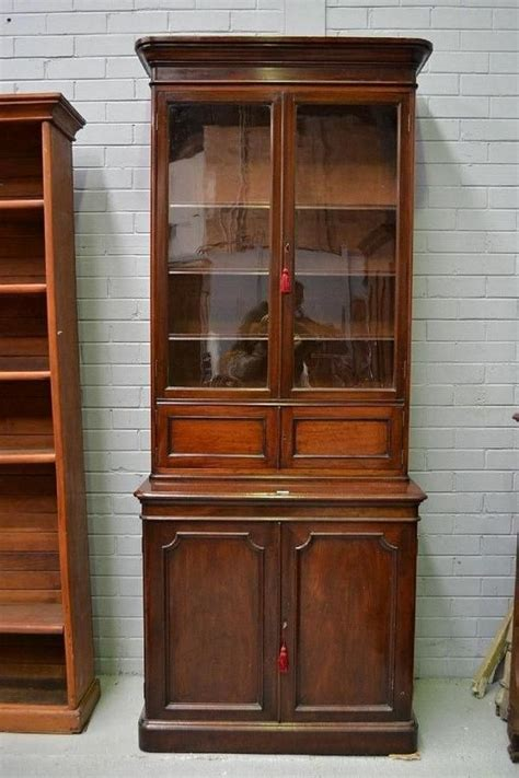 antique mahogany two height glazed bookcase with