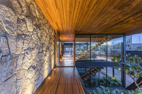 stones walls wood glass metal modern house brazil