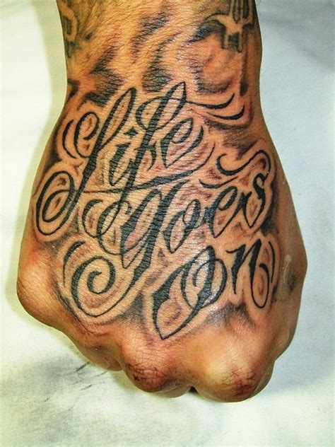 life goes on wording tattoo on hand