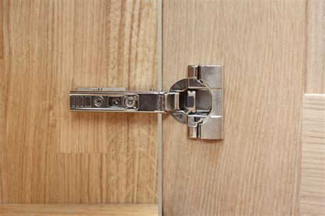adjusting kitchen cabinet hinges uk how do i adjust the hinges on my solid oak kitchen