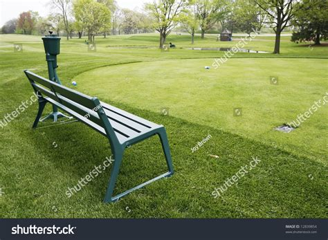 golf bench bench and ball washer on golf course stock photo 12839854