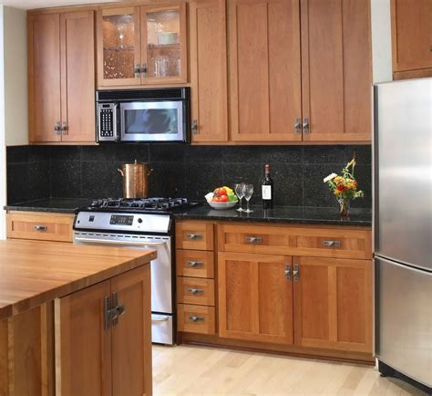 backsplash ideas for black granite countertops and maple