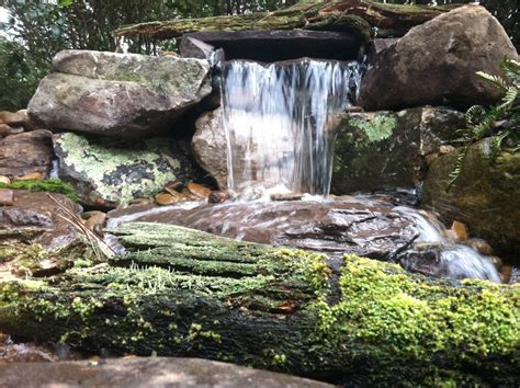 large rock waterfall island garden features
