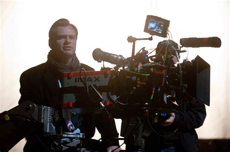 biography film director christopher nolan talks including catwoman in the dark