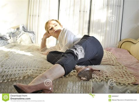 High Heels Chic Fortune Second model lying on bed 02 stock image image of