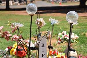 cemetery solar lights cemetery policy prompts debate about bereavement process