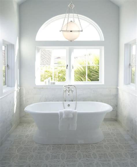 chandelier over bathtub stunning bathroom features vaulted ceiling accented with