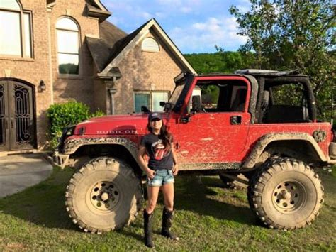 muddy jeep girls that s a happy jeep beside her muddy red lifted