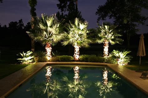 10 backyard getaways with landscape lighting
