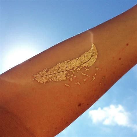 50 gold tattoo designs and ideas for women feel like a