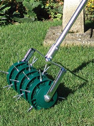 lawn aerating with solid tines or spikes