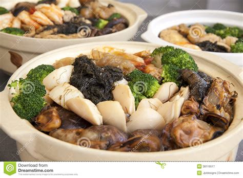 new year food cantonese poon choi cantonese big feast bowls closeup royalty free