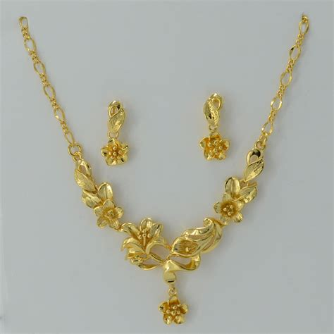 gold flower set jewelry necklace pendant earrings plant