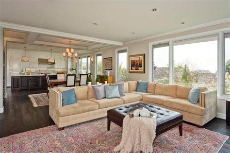 open floor plan decor this neutral family room is open to the photos hgtv