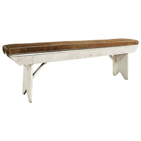 faux cowhide bench vintage farmhouse bench with palomino cowhide cushion at