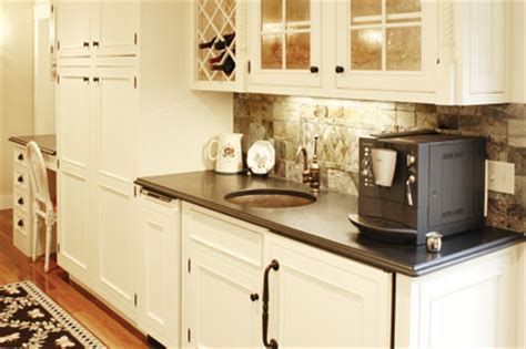 bright white kitchen with bronze hardware pictures to pin built in beverage storage new hshire magazine